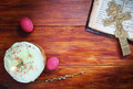 Composition about Christian Easter with red eggs and burning candle over the cake - PhotoDune Item for Sale