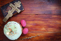 Composition about Orthodox Christian Easter with red eggs and burning candle over the cake - PhotoDune Item for Sale