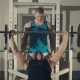 Man Training With Personal Trainer At The Gym - VideoHive Item for Sale
