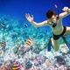 Snorkeler Maldives Indian Ocean coral reef. - PhotoDune Item for Sale