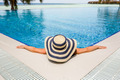 Woman in straw hat relaxing swimming pool - PhotoDune Item for Sale