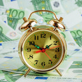 Alarm clock on a Euro banknotes - PhotoDune Item for Sale