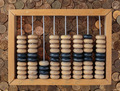 old wooden abacus on coins background - PhotoDune Item for Sale
