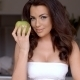 Seductive Young Woman Holding Fresh Green Apple - VideoHive Item for Sale