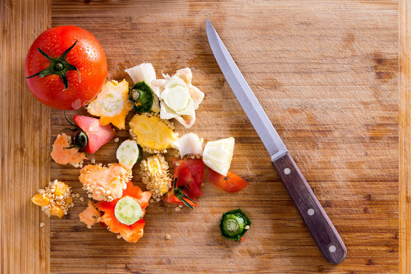 Organic Wastes on Wooden Chopping Board with Knife