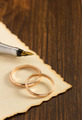 wedding ring and aged paper on wood - PhotoDune Item for Sale