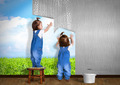 Little twins doing repair at home, hanging wallpaper. Renovation concept. - PhotoDune Item for Sale
