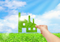 Hand hold factory iconon field and blue sky background, Eco green factory concept - PhotoDune Item for Sale