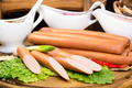 sausage on a wooden plate in a restaurant - PhotoDune Item for Sale