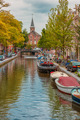 Amsterdam canal, church and typical houses, Holland, Netherlands. - PhotoDune Item for Sale