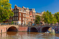 City view of Amsterdam canal, bridge and typical houses, Holland - PhotoDune Item for Sale