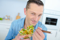 Man eating a healthy salad - PhotoDune Item for Sale