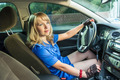 Pretty blonde girl in blue blouse and shorts driving her car - PhotoDune Item for Sale