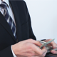 Businessman Takes Money out of His Wallet - VideoHive Item for Sale