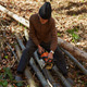 Old woodcutter at work with chainsaw - PhotoDune Item for Sale