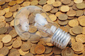 incandescent lamp on coins background - PhotoDune Item for Sale