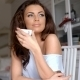 Gorgeous Young Woman Sitting Drinking Coffee - VideoHive Item for Sale