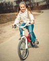 Little girl on a bicycle - PhotoDune Item for Sale