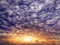setting sun among the curly rain clouds - PhotoDune Item for Sale