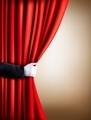 Hand in a white glove pulling curtain away. Theater.  - PhotoDune Item for Sale