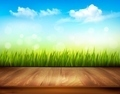 Wooden deck in front of green grass and blue sky background. - PhotoDune Item for Sale