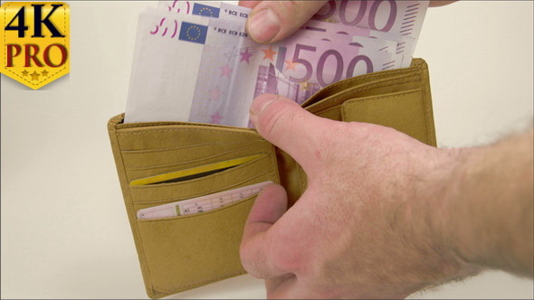 Man Couting Off the 2000 Euro Bills on the Wallet