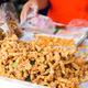 close up of cook hands and snacks at street market - PhotoDune Item for Sale