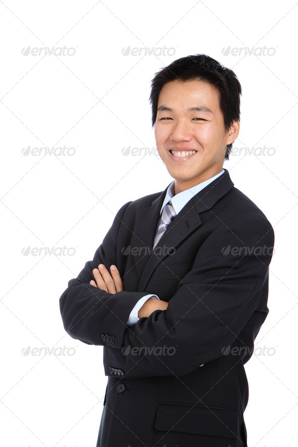 Business young man with confident smile - Stock Photo - Images