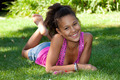 Young black teenage girl  lying on the grass - PhotoDune Item for Sale