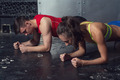 fit sportive man and woman doing plank core exercise training back press muscles