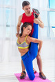 Active sportive woman stretching doing exercises aerobics or warming up