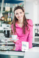 Cheerful waitress in a coffee shop - PhotoDune Item for Sale