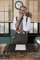Attractive vintage businessman standing in the office - PhotoDune Item for Sale