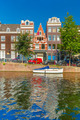 Amsterdam canals and typical houses, Holland, Netherlands. - PhotoDune Item for Sale