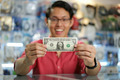 Happy Chinese Man Showing First Dollar Earning In Computer Shop - PhotoDune Item for Sale