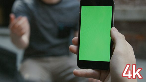 Guy Using Smartphone with Green Screen