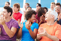 Audience Applauding At Outdoor Concert Performance