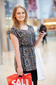 Woman In Shopping Mall Using Mobile Phone - PhotoDune Item for Sale