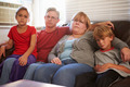 Portrait Of Unhappy Family Sitting On Sofa Together - PhotoDune Item for Sale