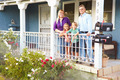 Portrait Of Family Standing On Porch Of Suburban Home - PhotoDune Item for Sale