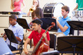 Pupils Playing Musical Instruments In School Orchestra - PhotoDune Item for Sale