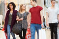 Group Of Young Friends Shopping In Mall Together - PhotoDune Item for Sale