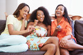 Group Of Women Sitting On Sofa Watching TV Together - PhotoDune Item for Sale