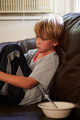 Unhappy Boy Sitting On Sofa At Home - PhotoDune Item for Sale