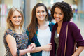 Three Female Friends Shopping In Mall Together - PhotoDune Item for Sale