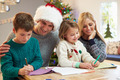 Family Writing Christmas Cards Together - PhotoDune Item for Sale