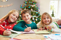 Three Children Writing Letters To Santa Together - PhotoDune Item for Sale