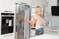 commercial cute girl in front of refrigerator - PhotoDune Item for Sale