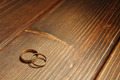 Golden Wedding Rings On The Wooden Background - PhotoDune Item for Sale