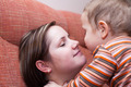 Mother kissing her child boy - PhotoDune Item for Sale